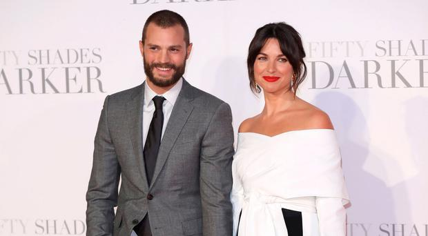 Glamour couple: Jamie Dornan and Amelia Warner at the Fifty Shades Darker premiere in London last month