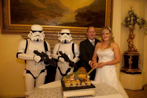 New frontier: Colin and Adele Symington cut the cake with Star Wars stormtroopers