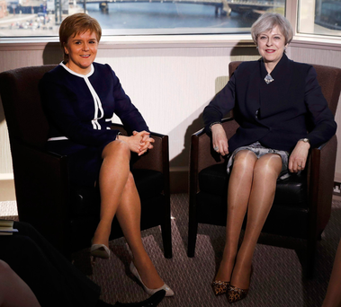 Skirting isse: the image of Prime Minister Theresa May (right) and Scottish First Minister Nicola Sturgeon that caused a furore after the Daily Mail featured it on its front page. Photo: Russell Cheyne/PA Wire