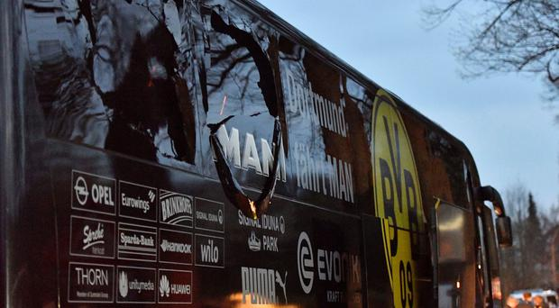 Under attack: three devices exploded on Tuesday as Borussia Dortmund footballers were on their way to a match against Monaco, injuring Marc Bartra
