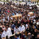 Religious persecution: mourners at the funeral for Christians killed by IS in Egypt on Palm Sunday