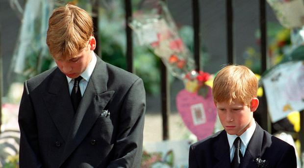 So sad: Princes William and Harry as Princess Diana's coffin is taken out of Westminster Abbey following her funeral service