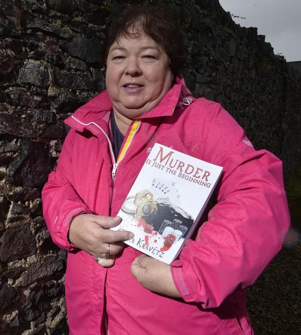 Debut novel: Carol with her book, Murder Is Just The Beginning