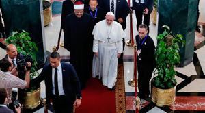 Papal message: Pope Francis walks alongside Muslim clerics during a visit to the prestigious Sunni institution Al-Azhar in Cairo yesterday