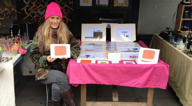 Battling back Charlotte Reed selling her book and drawings at her Portobello Market stall in London