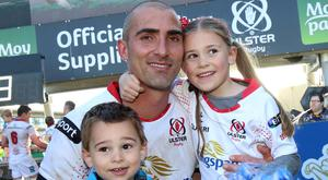 Ruan Pienaar gets a hug from children Lemay and Jean-Luc