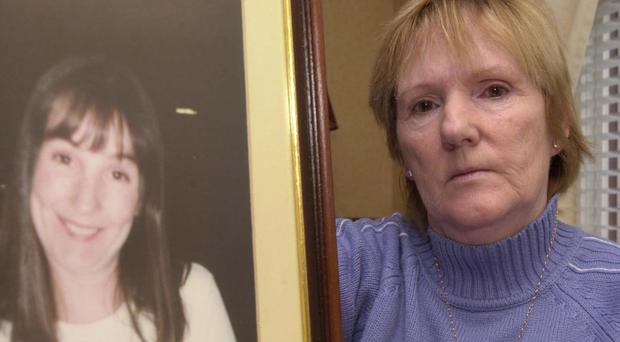 Bridie McGrellis with a picture of her daughter Caroline, who was killed by her husband John Crossan