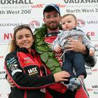 Glenn Irwin, along with partner Laura and son Freddie, celebrates victory in the Superbike North West 200 feature race