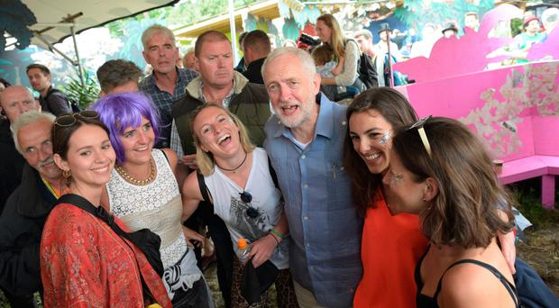 In tune: Labour leader Jeremy Corbyn with young festival-goers at Glastonbury