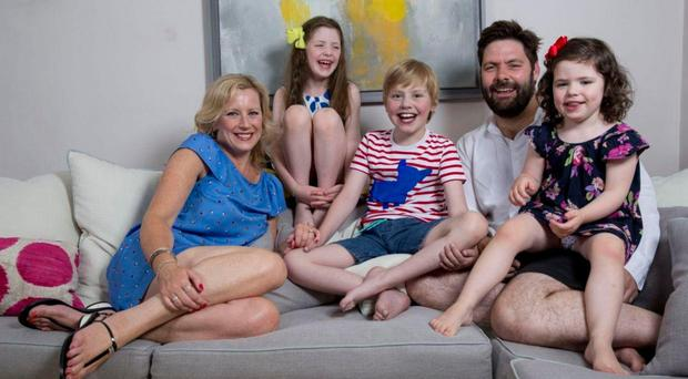 BATTLE FOR LIFE: Peter and Lisa Flint with son Oliver, who because of a serious condition needs a heart transplant, and daughters Emmeline and Matilda