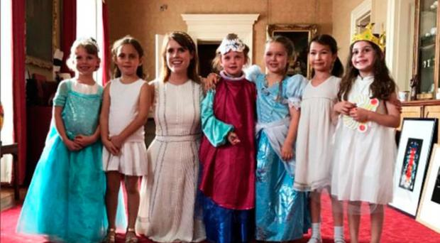 Royal approval: Princess Eugenie meets Harper Beckham (third from right) with friends at Buckingham Palace