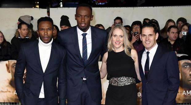Ricky Simms and his wife Marion Steininger with Usain Bolt at the World Premiere of I Am Bolt in London