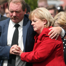 Rodney and Karen McIlwaine at the funeral of their son Dean in Carnmoney