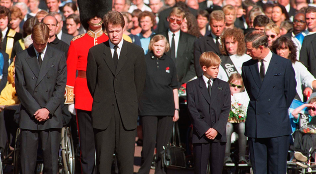 Sad day: Prince Charles with his sons, Prince Harry and Prince William, with Earl Spencer outside St James's Palace during Princess Diana's funeral