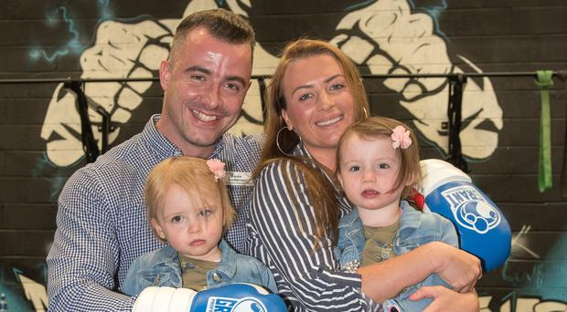 Family man: Kevin Anderson with his wife, Sarah, and twin daughters Lauren and Aimee (2) at the Mayhem Gym