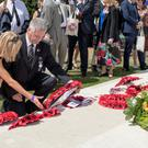 Poignant visit: David Nicholl and sister Lesley lay a wreath in honour of their grandfather William