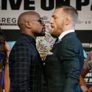 Money talks: Floyd Mayweather Jnr and Conor McGregor head to head at one of their pre-fight Press conferences
