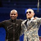 Big money: Floyd Mayweather Jr (left) and Conor McGregor made fortunes from their bout