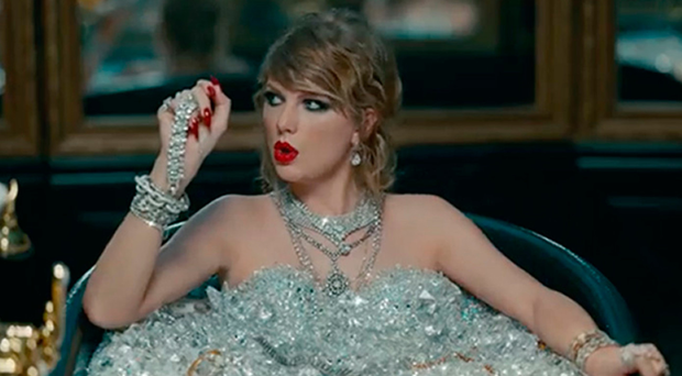 Same tune: Taylor Swift in a bath full of jewels in her not-so-subtle video for Look What You Made Me Do