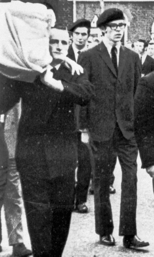 Chequered life: Gerry Adams, the young republican in 1973 forms part of an IRA guard of honour at a IRA bomber's funeral
