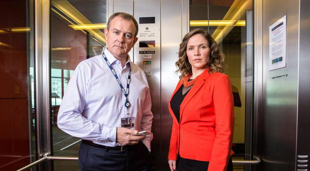 Going up: Hugh Bonneville as Ian Fletcher and Jessica Hynes as Siobhan Sharpe in W1A