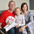 Fighting fit: Julie McAllister with husband Derek and daughter Emily