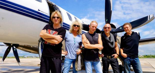 Rock legends: Vivian (second from right) with his bandmates from Def Leppard