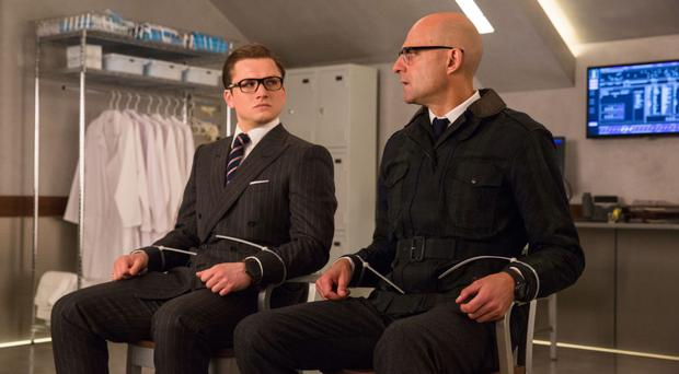 Suits you: Eggsy (Taron Egerton) and Merlin (Mark Strong)