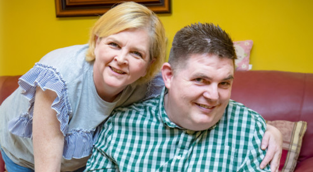 Close bond: Yvonne looks after her brother, Stephen, in Toomebridge