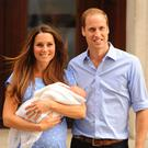 Growing family: The Duke and Duchess of Cambridge, pictured with first baby, Prince George, are believed to want a home birth for their third child