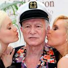Porn captain: Hugh Hefner with 'playmates' Holly Madison (left) and Bridget Marquardt