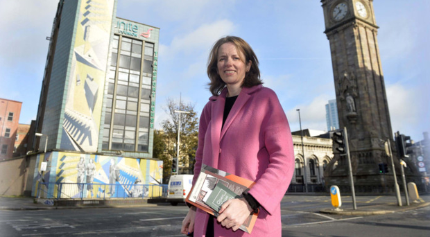 Judith Cole beside two of Belfast's most recognisable landmarks, Transport House (left) on High Street and the Albert Clock