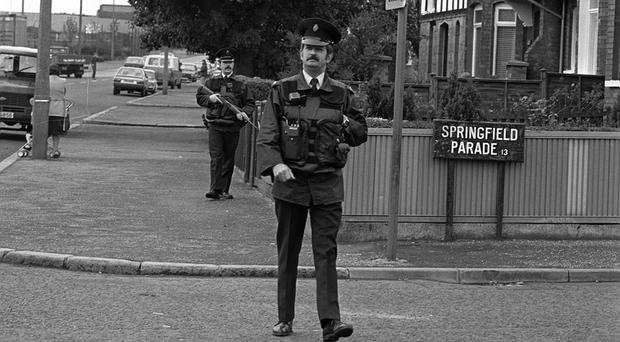 Armed RUC officers on foot patrol in Belfast during the Eighties