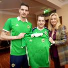 Good sport: Northern Ireland's Kyle Lafferty with Mark Dobson and mum Jo-Anne
