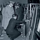 Adolf Hitler examining seized pictures