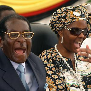 All change: Zimbabwean President Robert Mugabe and his wife Grace before the recent coup