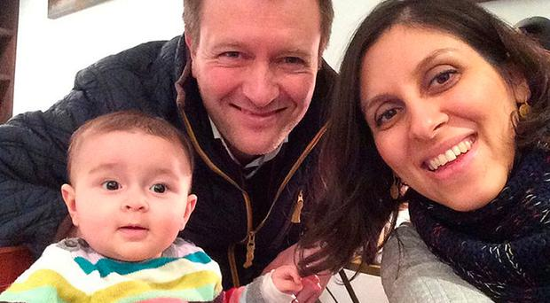Separate lives: Nazanin Zaghari-Ratcliffe, her husband Richard Ratcliffe and their daughter Gabriella, who lives with her grandparents