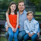 Staying strong: Barry Williamson with his daughter Mya (13) and son Rhys (9)