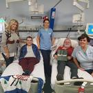 Festive mood: Mark Dobson drew the winning ticket for his Christmas appeal while on dialysis at Daisy Hill with, from left, mum Jo-Anne, nurse Carolyn Hutchinson, patient John Stewart and healthcare assistant Adele Murphy