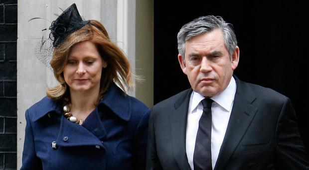Gordon Brown, pictured with wife Sarah, writes in his memoirs that he regrets not being more open about his religious views while in Number 10