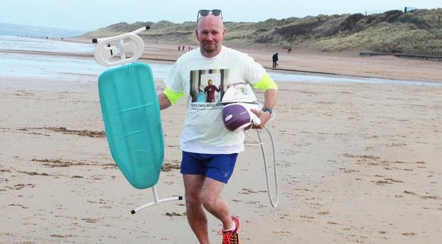 Portrush man Andy Farrer with ironing board and iron
