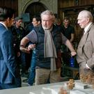 Take two: from left, Mark Wahlberg, director Ridley Scott and Christopher Plummer re-shoot scenes