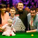 Mark Allen celebrates victory with wife Kyla, stepson Robbie, and baby Harleigh after his triumph in the Dafabet Master's Final against Kyren Wilson