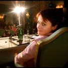 A mischievous glint in Dolores O'Riordan's eyes as she prepares to face the Press