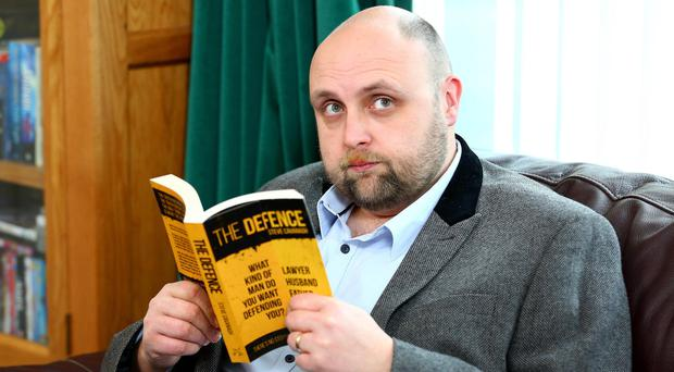 Engaging read: author Steve Cavanagh with a copy of his first novel, The Defence
