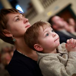 A mum and child at a live show