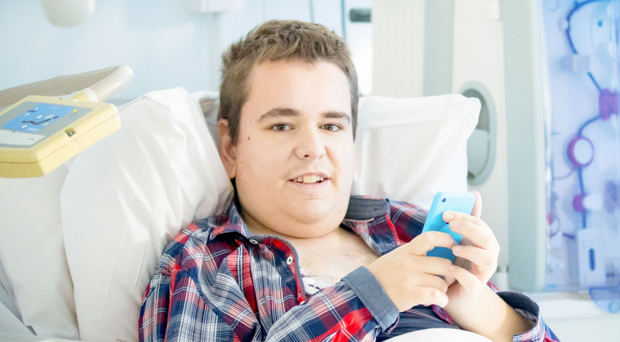 Moving tale: Mark Dobson in hospital