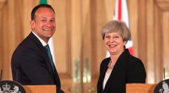 Showing respect: Leo Varadkar and Theresa May greet each other