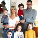 Happy family: Emma Lewis and husband Jonathan with their children, Annabelle (7), Mabel (5), Bobby (4), Essie-May (2), and Jon (10 months)