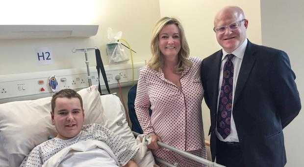 Jo-Anne Dobson, son Mark, and consultant surgeon Tim Brown